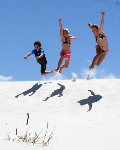 playing on the white sands, Rarawa Beach, 20 minutes from Pukenui Holiday park