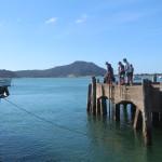 Fishing off Pukenui Wharf, a short walk from Pukenui Holiday Park